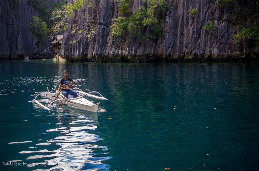 coron tagbanua guard in a boat